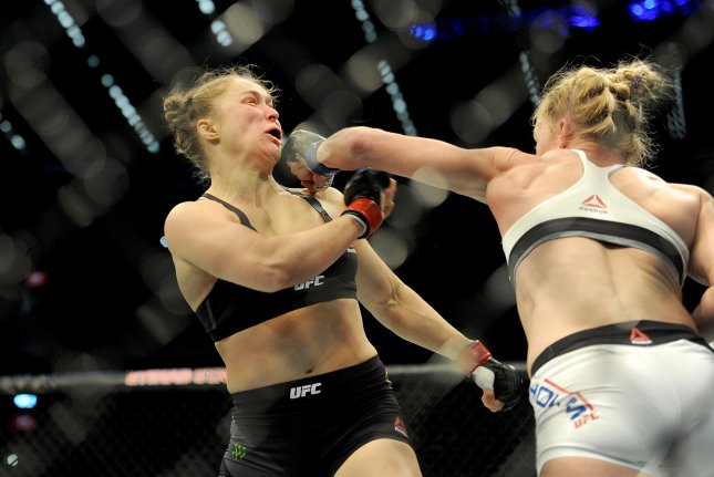 Holly Holm strikes defending champion Ronda Rousey (L) in the Women's Bantamweight Bout during the UFC 193 Australia event in 2015 at Etihad Stadium in Melbourne. File Photo by Joe Castro/EPA