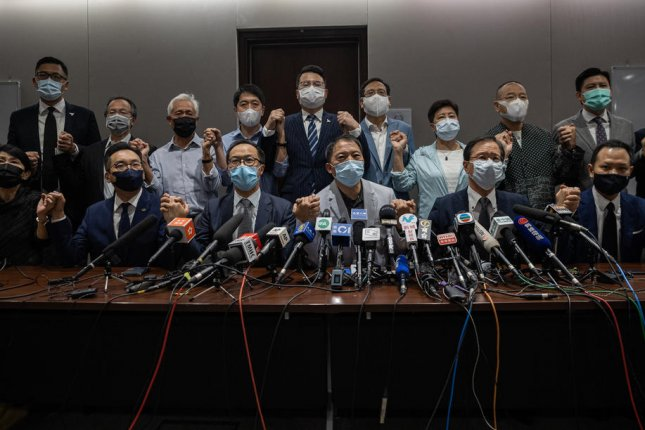 More than a dozen pro-democracy lawmakers announce their resignations from the Legislative Council during a news conference in Hong Kong Wednesday. Photo by Jerome Favre/EPA-EFE