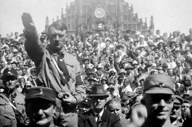 Adolf Hitler attends a Nazi Party rally in Nuremberg, Germany in 1928. On Aug. 2, 1934, with the death of German President Paul von Hindenburg, then-Chancellor Hitler became absolute dictator of Germany. File Photo by NARA/UPI