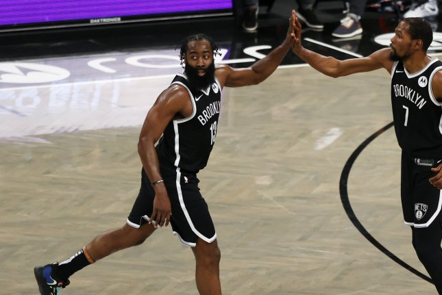 Brooklyn Nets guard James Harden (L), shown Jan. 18, 2021, has been out since suffering a hamstring injury in Game 1 of the Nets' second-round series against the Milwaukee Bucks. File Photo by Jason Szenes/EPA-EFE