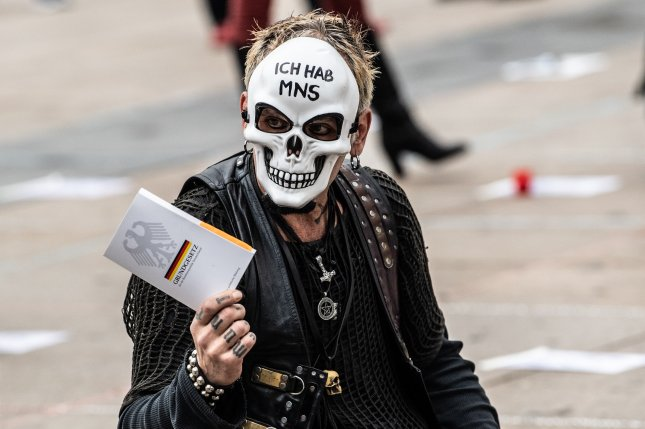 A man wearing a mask attends a protest against coronavirus pandemic regulations in Berlin, Germany, on Halloween on Saturday. Photo by Filip Singer/EPA-EFE