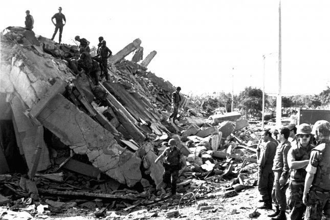 Service members pick through the rubble following the bombing of the U.S. Marine Corps barracks in Beirut, Lebanon on Oct. 23, 1983. Iran and Hezbollah masterminded the attack. File Photo by U.S. Marine Corps