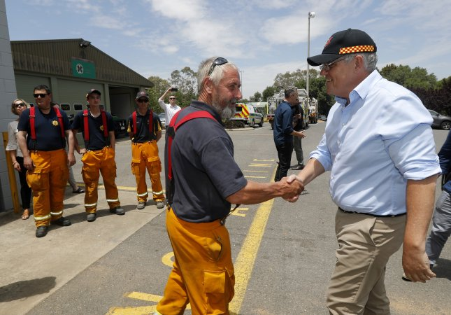 Australian Prime Minister Scott Morrison said Sunday he will propose a commissionto determine how the federal government will provide relief from the brushfire's affecting much of the nation. Photo by Kelly Barnes/EPA-EFE