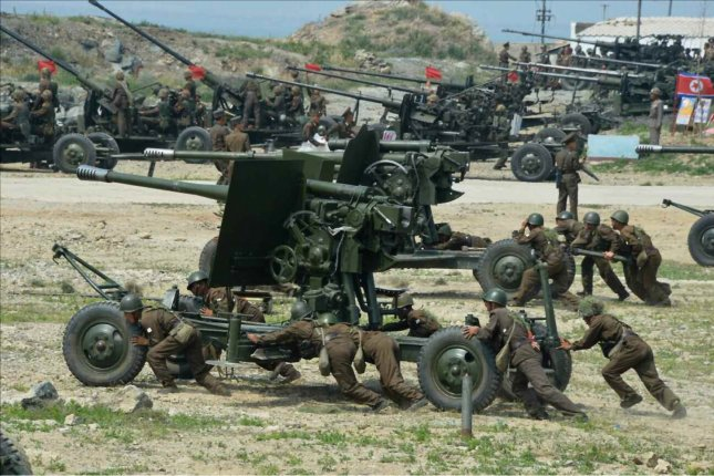 North Korean soldiers push anti-aircraft guns during a shooting contest. The military is requesting the donation of tin foil for protection from satellites, according to a report. Photo by Yonhap News Service/UPI