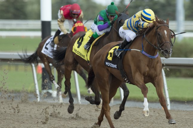 Pink Lloyd under Jockey Eurico Da Silva captures the Grade III, $125,000 dollar Vigil Stakes for owner Entourage Stable and trainer Robert Tiller on Sunday at the Vigil Stakes in Ontario, Canada. Photo by Michael Burns/Woodbine