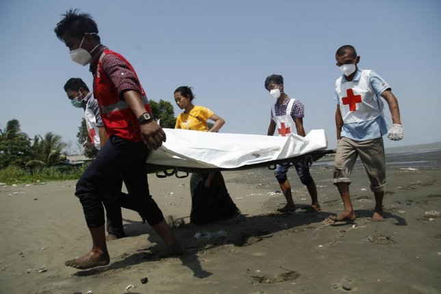 The Myanmar Red Cross moves the body of a World Health Organization worker to an ambulance in Rakhine State, Myanmar, on April 21. The worker died amid ongoing fighting in the largely Rohingya state. Photo by Nyunt Win/EPA-EFE