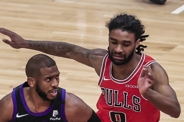 Chicago Bulls guard Coby White (R), shown Feb. 26, 2021, underwent surgery to repair the left shoulder injury and will miss at least four months. File Photo by Tannen Maury/EPA-EFE