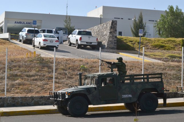 Members of the Mexican Army guard outside of Salvatierra General Hospital, in the municipality of Salvatierra, Mexico, in January after a group of armed men killed a man inside in a dispute related to drug trafficking. File Photo by Mario Armas/EPA-EFE
