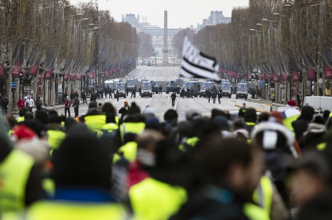 Protesters gather during a yellow jacket demonstration on the Champs Elysees in Paris, on Saturday. Photo by Etienne Laurent/EPA