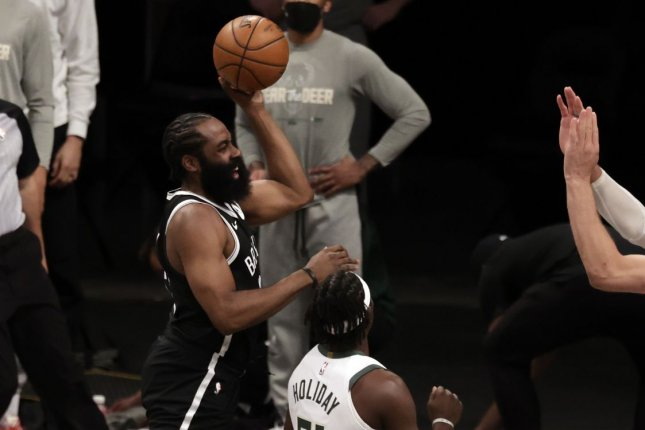 Brooklyn Nets guard James Harden (L), shown June 5, strained his hamstring in Game 1 against the Milwaukee Bucks and has been sidelined since. File Photo by Jason Szenes/EPA-EFE