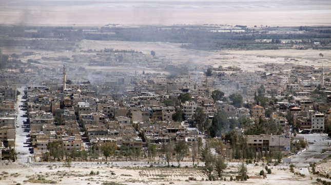 A file photo from April 2016 shows a general view of the city of Homs, Syria. At least 32 people were killed and 24 more wounded after a pair of suicide bombings targeted two security bases in the city on Saturday. Photo by Youssef Badawi