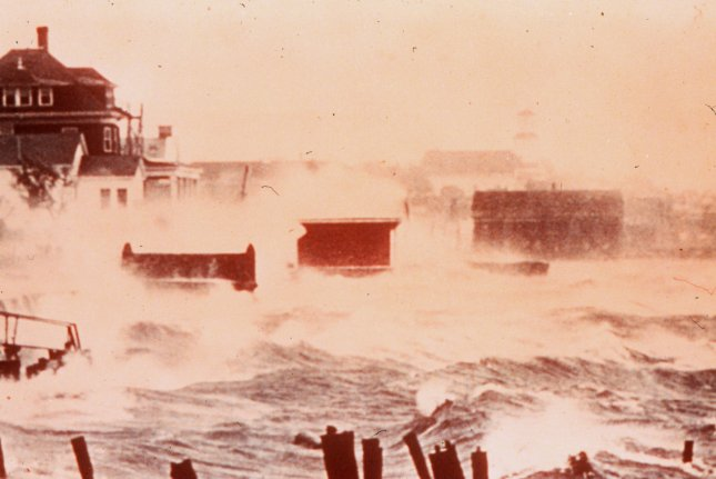 Storm surge from Hurricane Carol batters the coast of Connecticut on August 31, 1954. On August 30, 1954, Hurricane Carol prompted evacuations in North Carolina. File Photo courtesy NOAA