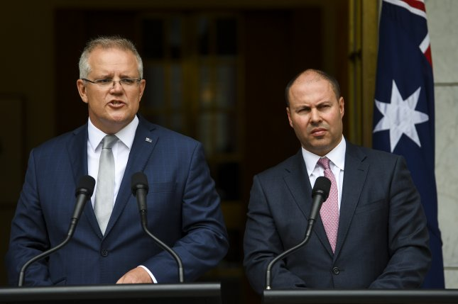 Australian Prime Minister Scott Morrison (L) and Australian Federal Treasurer Josh Frydenberg speak during a press conference regarding the government's bushfire response at Parliament House in Canberra on Monday. Photo by Lukas Coch/EPA-EFE