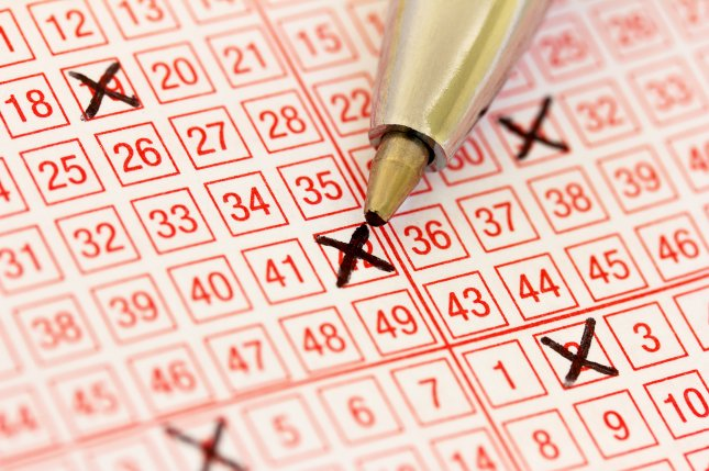A British Columbia woman said her husband's text announcing his $10 lottery win led her to check her own tickets and discover a $360,000 jackpot. Photo by Robert Lessmann/Shutterstock