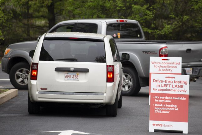 Cars line up at a CVS Pharmacy drive-through COVID-19 testing center in Bridgewater, Mass., on May 15. File photo by CJ Gunther/EPA-EFE