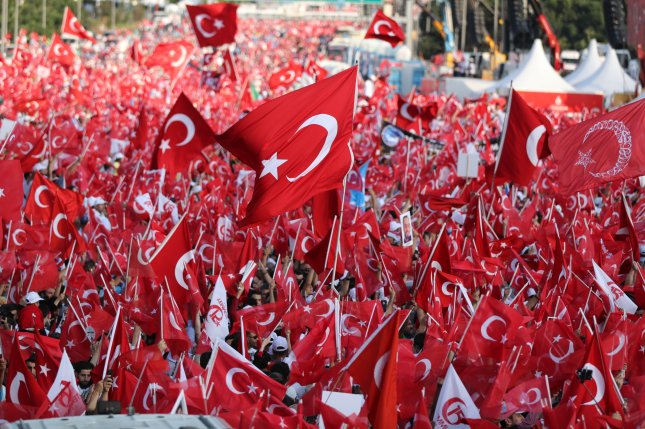 Turkish citizens celebrate during a ceremony commemorating the first anniversary of a failed coup attempt at the Bosphorus Bridge in Istanbul, Turkey, on July 15, 2017. File Photo by Tolga Bozoglu/EPA-EFE