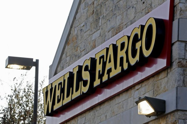 A Wells Fargo & Co. sign hangs on a bank branch in Rockwall, Texas, on February 6, 2020. The bank announced it was ending personal lines of credit for its customers in 60 days. File Photo by Larry W. Smith/EPA-EFE