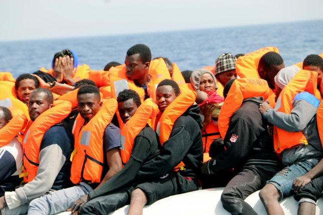 Many Libyan migrants end up in inhumane detention centers while others risk a dangerous trip across the Mediterranean Sea in search of opportunities in Europe. On Friday, Libya announced three of the worst detention centers will shut down. File Photo by Javier Martin/EPA-EFE