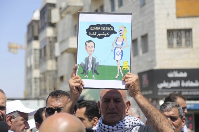 A Palestinian activist holds up a placard during a protest ahead of the scheduled visit of White House adviser Jared Kushner and his delegation in the West Bank town of Ramallah on Thursday. Photo by EPA-EFE