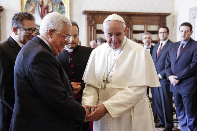 Pope Francis shakes hands with Palestinian President Mahmoud Abbas during a private audience in the Vatican in 2017. The two met again Monday to discuss recent developments. File Photo by Giuseppe Lami/EPA