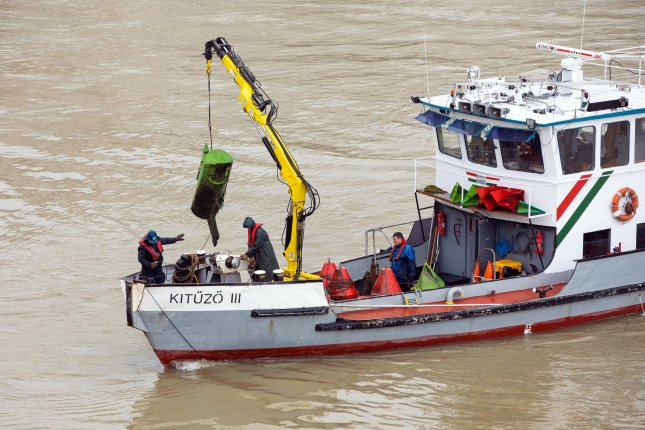 A rescue ship searches for survivors Thursday on the Danube River in Budapest, Hungary, after two boats collided. Photo by Balazs Mohai/EPA-EFE
