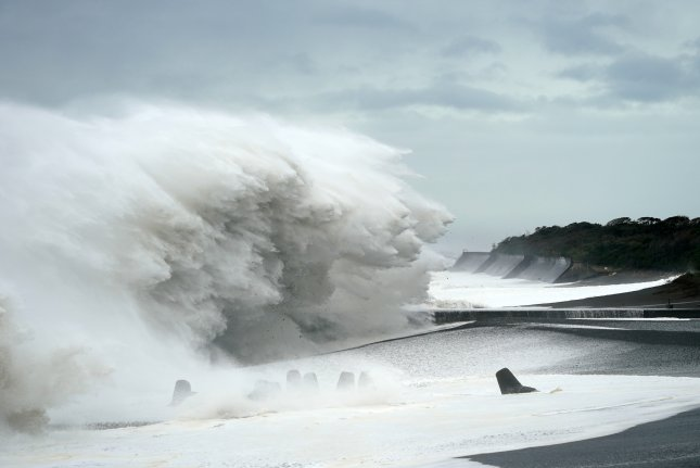 Surging waves generated by Typhoon Hagibis hit the seashore in Mihama, Mie prefecture, Japan, on Saturday. Photo by Franck Robichon/EPA-EFE