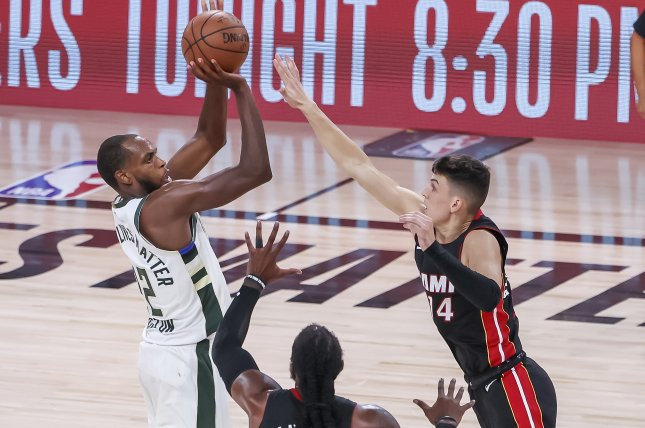 Milwaukee Bucks forward Khris Middleton (L) scored a game-high 25 points in a win over the Miami Heat on Tuesday in Miami. Photo by Erik S. Lesser/EPA-EFE