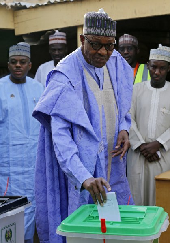 Nigerian president Muhammadu Buhari casts his ballot in the presidential elections in Daura, Katsina, Nigeria. Photo by George Esiri/EPA-EFE