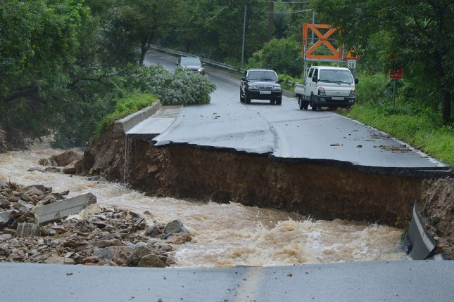 A road was collapsed from heavy rain, in Chungju, South Korea, on Sunday. Photo by Yonhap News Agency/EPA-EFE