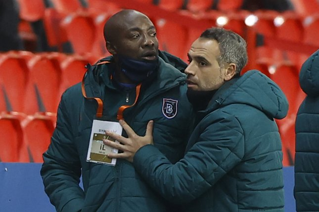 Istanbul Basaksehir assistant coach Pierre Webo (L) reacts during a UEFA Champions League Group H match against Paris Saint-Germain on Tuesday in Paris. Photo by Ian Langsdon/EPA-EFE