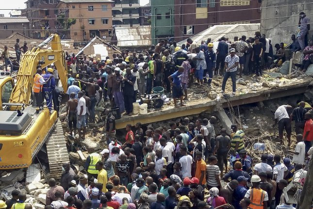Rescuers work at the scene of a building collapse in Ita Faji, Lagos, Nigeria, on Wednesday. Photo by Israel Ophori/EPA-EFE