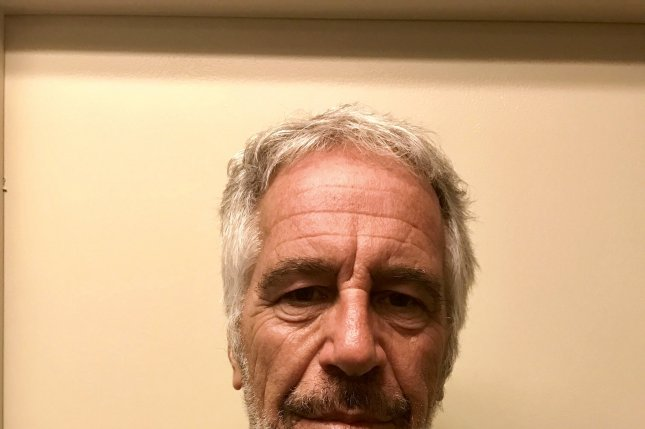 The warden at the federal jail where Jeffrey Epstein was found dead Saturday has been reassigned and two staffers have been placed on leave, the Justice Department said Tuesday. File Photo by New York State Division of Criminal Justice/EPA-EFE