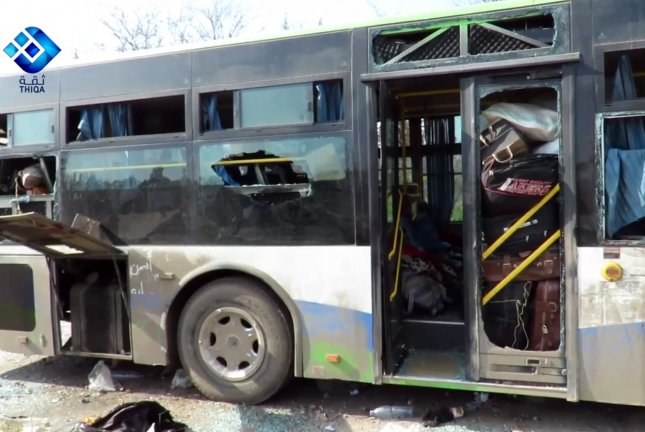 Human rights observers said at least 112 people were killed Saturday in a suicide bombing targeting a bus convoy carrying evacuees from rebel-besieged towns. The buses were carrying the evacuees from the towns of Kefraya and al-Foua'a towns to the al-Rashideen area near Aleppo. Photo by TIQAH NEWS AGENCY/EPA