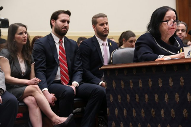 Relatives testify Thursday before a House subcommittee, urging federal lawmakers to act in securing the release of several Americans held hostage in Iran. Photo by Patty Nieberg/Medill/UPI