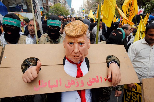 An Iranian man wearing an effigy mask of U.S.  President Donald Trump takes part in an anti-U.S.  demonstration marking the 40th anniversary of U.S.  Embassy in Tehran on Monday. Photo by Abedin Taherkenareh/EPA-EFE