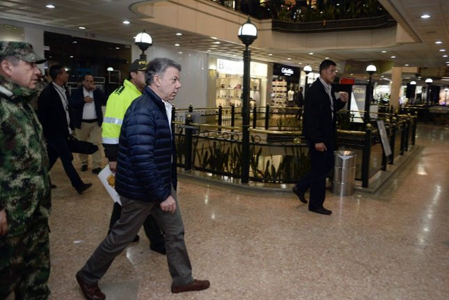 Colombian President Juan Manuel Santos (C) visits the Andino mall in Bogota, Colombia, on Saturday night. Three women were killed and 11 people injured in an explosion the mall in northern Bogota, according to Colombian officials. Photo by Colombian Presidency/EPA