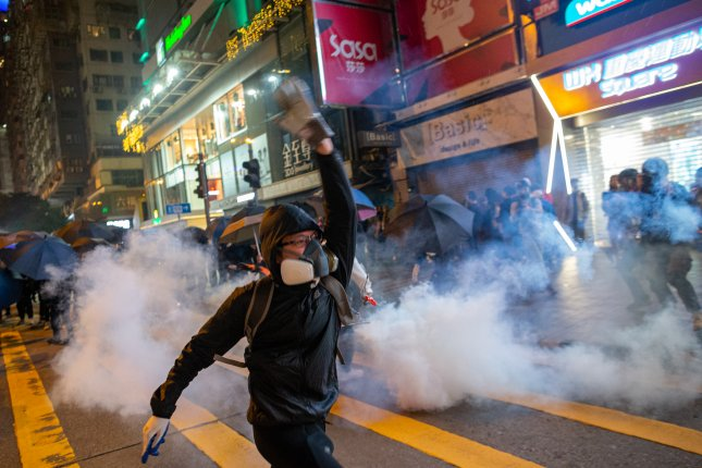 Police fired multiple rounds of tear gas in the tourist district of Tsim Sha Tsui on Christmas eve, after clashes broke out inside a shopping mall as a large number of protesters join a Christmas shopping rally. Photo by Jerome Favre/EPA-EFE