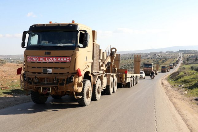A Turkish military convoy is seen Thursday moving east of Idlib, Syria. Turkish President Recep Tayyip Erdogan has said it's only a matter of time before Ankara starts fighting to keep the Syrian army from opposition-held Idlib province. Photo by Yahya Nemah/EPA-EFE