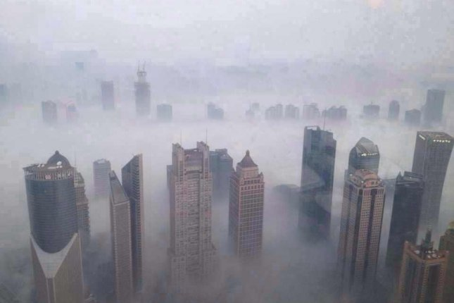 A dense layer of smog shrouds a Chinese city. Photo by erhard.renz/Flickr/CC