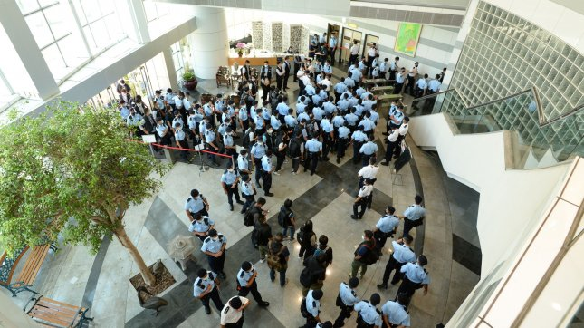 Police officers arrive at the office of Next Media, publisher of Apple Daily, in Hong Kong, China, on Thursday. Hong Kong's national security police arrested five directors of the Apple Daily newspaper on suspicion of conspiracy to collude with foreign forces. Photo by Apple Daily/EPA-EFE