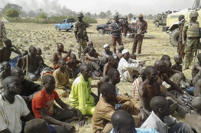 Nigerian military with young men rescued from suspected Boko Haram terrorists after an operation in Borno State, Nigeria, February 3, 2016. UNICEF said Boko Haram recruited 2,000 child soldiers to fight for the Islamist organization in 2016. File Photo by STR/EPA