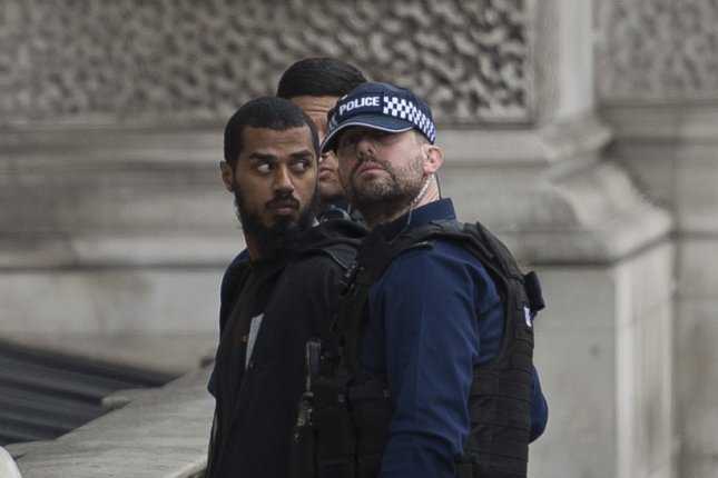 London's Metropolitan Police said a 27-year-old knife-carrying man was arrested near the Houses of Parliament in Westminster on suspicion of possession of an offensive weapon and on suspicion of the commission, preparation and instigation of acts of terrorism. Photo by Will Oliver/EPA