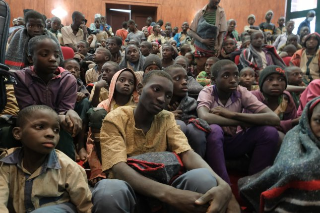 A group of abducted students are seen after their rescue in Kankara, Katsina State, Nigeria, on December 18, 2020. Dozens of different students who were kidnapped in northern Nigeria last week have since been released, officials said Tuesday. File Photo by EPA-EFE