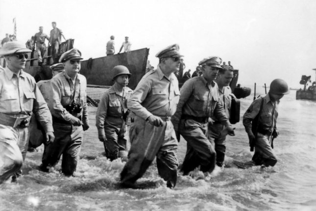 General Douglas MacArthur and staff, accompanied by Philippine president Sergio Osmena (right), land at Palo Beach, Leyte, on Oct. 21, 1944. File Photo by US Army/UPI