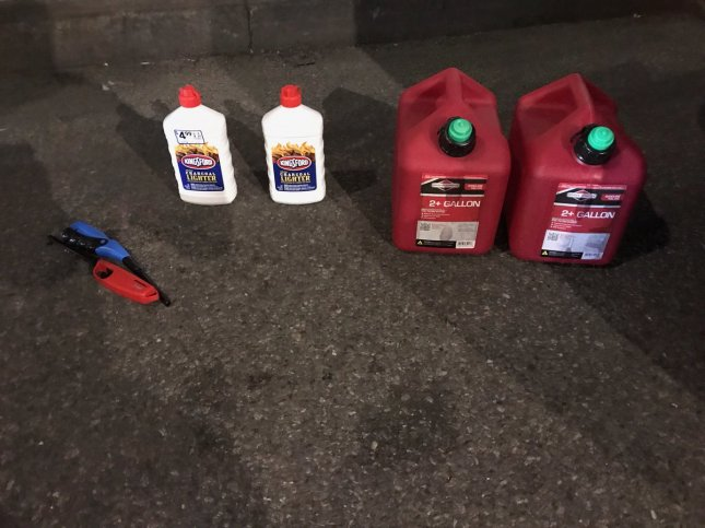 A man was apprehended after having entered St. Patrick's Cathedral with two two-gallon gas cans, two bottles of lighter fluid and two lighters. Photo courtesy of New York Police Department/Twitter