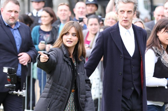Jenna Coleman (L) and her Doctor Who co-star Peter Capaldi promote Season 8 in London on August 22, 2014. File photo by Twocoms/Shutterstock