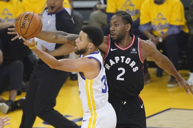 Toronto Raptors forward Kawhi Leonard (2) tries to block a shot against Golden State Warriors point guard Stephen Curry (30) during Game 3 of the NBA Finals on Wednesday night at Oracle Arena in Oakland, California. Photo by John G. Mabanglo/EPA-EFE