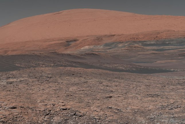 The Mars Curiosity rover was sent to Gale Crater -- and took this picture of Mount Sharp, in the middle of the crater -- but researchers have chosen to send the Perseverance rover to Jericho Crater to investigate ancient lake bed and river delta. Photo by NASA/JPL-Caltech/MSSS