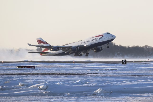 A British Airways 747 departs Logan International Airport in Boston en route to London's Heathrow Airport. As of Friday, BA is retiring its fleet of nearly three dozen 747s, which it began flying 31 years ago. File Photo by John Cetrino/EPA-EFE