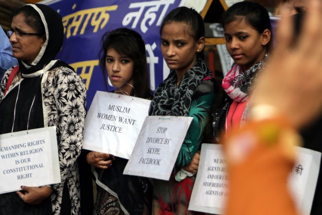 Activists from Bharatiya Muslim Mahila Andolan and Muslims for Secular Democracy hold placards during a protest against justification of the Indian practice of triple talaq, or instant divorce, and polygamy in Mumbai, India, September 2016. File photo by EPA/Divyakant Solanki